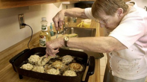 Joyce Taylor working her magic on a pan of crab cakes.