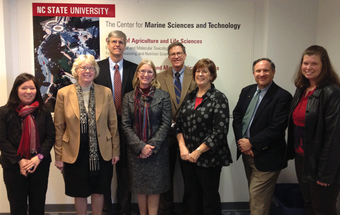 Coastal and Marine Sciences External Review Team from the American Association for the Advancement of Sciences, as well as members of the UNC General Administration and NC State University.  From left to right: Dr. Rieko Yajima (AAAS), Dr. Nancy Targett (University of Delaware), Dr. Steven Lohrenz (University of Massachusetts), Dr. Jackie Dixon (University of South Florida), Dr. Chris Brown (UNC General Administration), Dr. Terri Lomax (NC State University), Dr. Chris D'Elia (Louisiana State University), and Dr. Courtney Thornton (UNC General Administration).