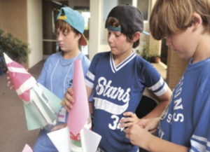 Down East Middle School students, from left, Raegann Garner, Landon Tunstall, and Corey Johnson, as part of an engineering project, build bottle rockets during The Bridge Down East summer program at Harkers Island Elementary School (Cheryl Burke photo)