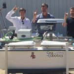 Unmanned surface vehicle with 3 of the 4 Principal Investigators