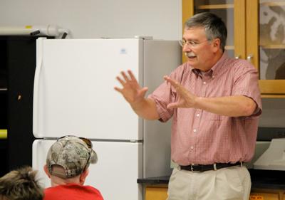 Dr. Green delivering a presentation during a seafood safety workshop.